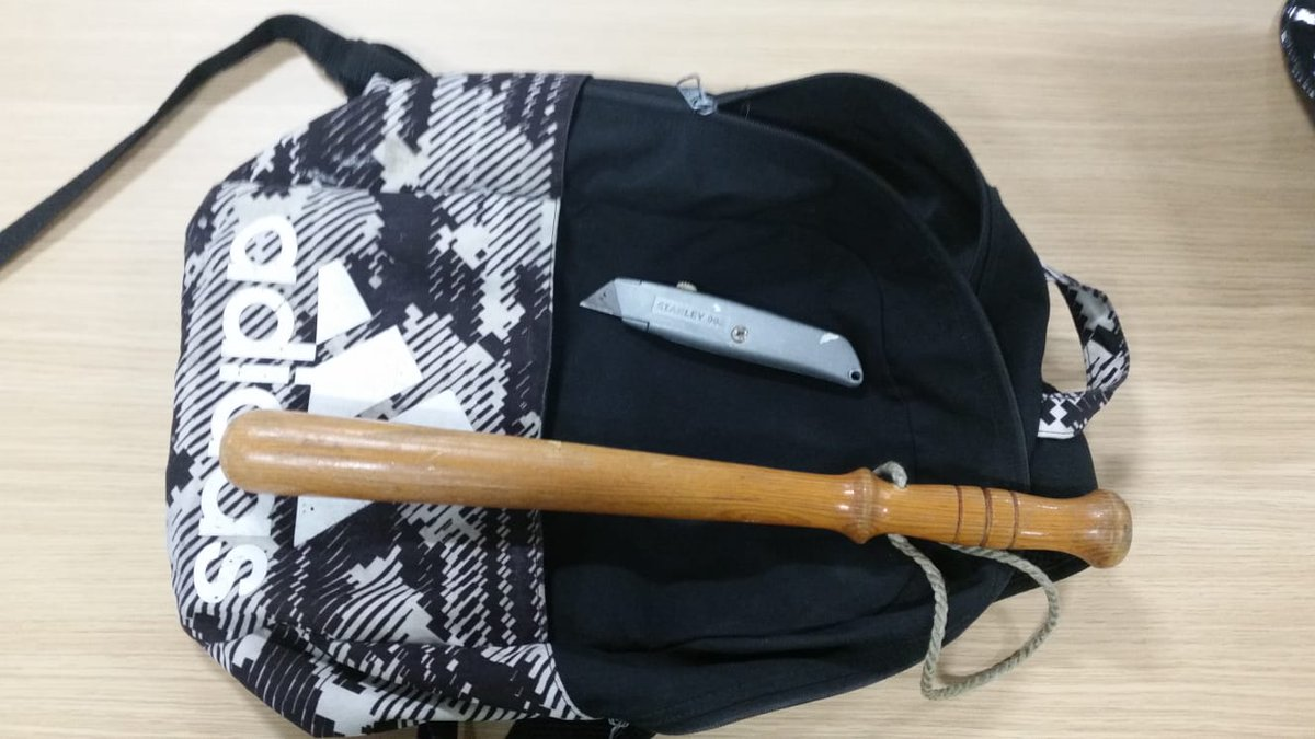 School pupils bag with seized weapons